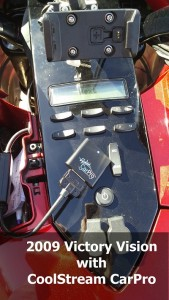 CoolStream CarPro attached to 30-pin cable on a 2009 Victory Vision
